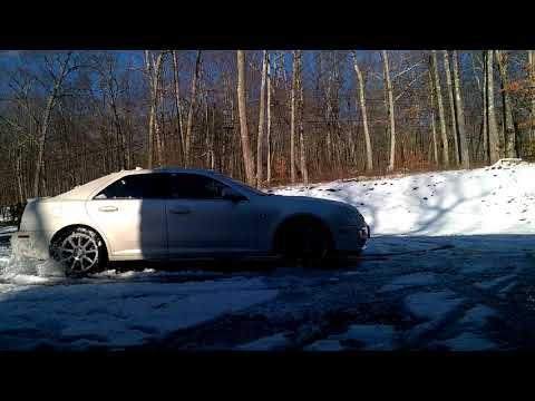 05 Cadillac STS attempts AWD snow donuts in driveway
