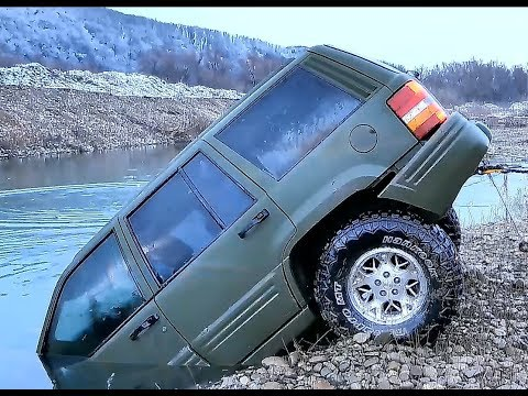 Offroad 4x4 Nissan patrol Land rover defender Mitsubishi pajero and Jeep in water 4K